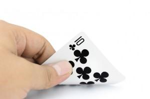 Ten of clubs in hand