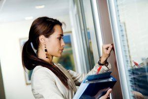 Businesswoman knocking on office door