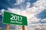 2017 Just Ahead Green Road Sign Against Clouds